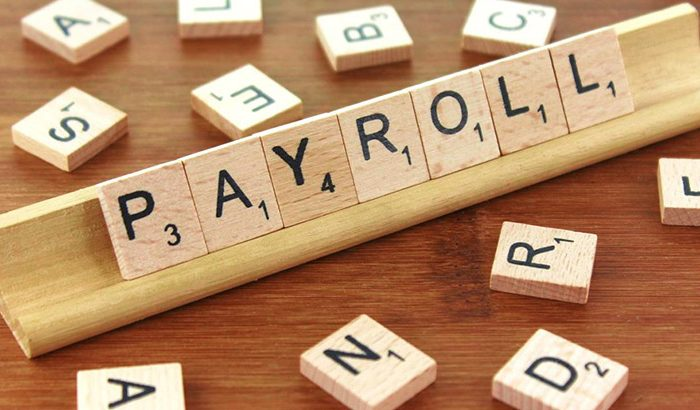 Which firms should consider outsourcing payroll in HK?